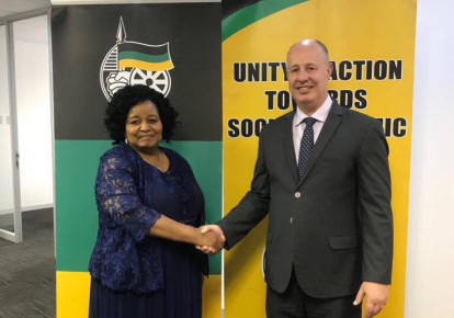 Regional Cooperation Minister Tzachi Hanegbi shakes hands with the ANC's International Relations Subcommittee chairwoman Edna Molewa during a meeting in South Africa last week. (Facebook) (photo credit: FACEBOOK)