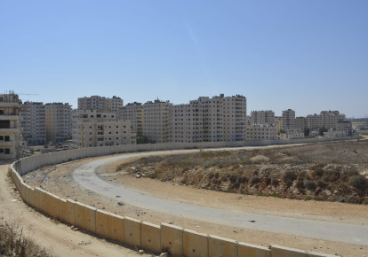 A view of Kafr Akab, one of the neighborhoods behind the security barrier that would be affected by Elkin's plan. (Udi Shaham) (photo credit: UDI SHAHAM)