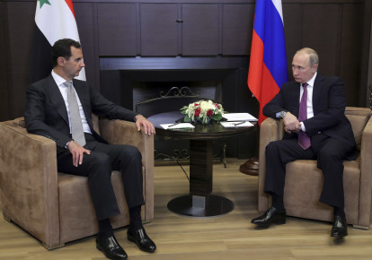 Russian President Vladimir Putin meets with Syrian President Bashar Assad in Sochi, Russia, November 2017 (photo credit: SPUTNIK PHOTO AGENCY / REUTERS)
