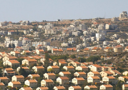 THE OFRA SETTLEMENT is seen from the Amona outpost in the West Bank. (photo credit: RONEN ZVULUN/REUTERS)