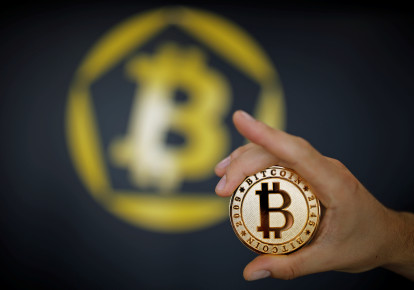 A Bitcoin (virtual currency) coin is seen in an illustration picture (photo credit: BENOIT TESSIER/REUTERS)