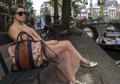 "Victoria Koblenko, 33, poses on the bench which was used in the movie ""The Fault In Our Stars"", in Amsterdam July 11, 2014. (photo credit: REUTERS)"