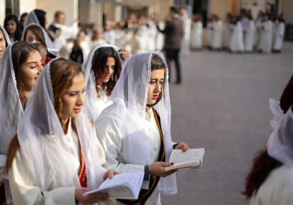 Syriac Christian women pray during mass at the Saint Efram Syriac Orthodox Church in Qamishly, Syria (photo credit: RODI SAID / REUTERS)