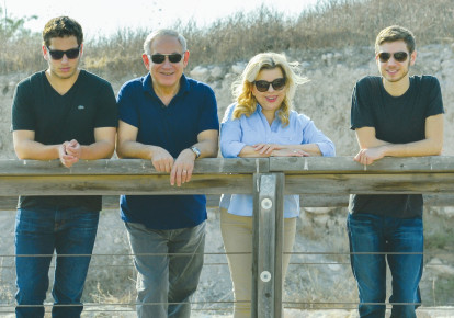 PRIME MINISTER Benjamin Netanyahu and his wife, Sara, tour the Magshimim Forest together with their sons Yair (right) and Avner in 2016. (GPO) (photo credit: GPO)