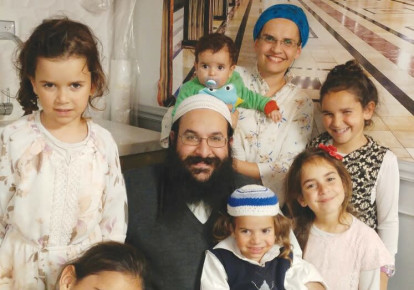 RAZIEL SHEVACH, whom a terrorist murdered on January 9th, 2018, is surrounded by his wife and six children in this recent photograph. (photo credit: Courtesy)