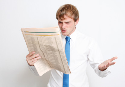 Man reads newspaper in frustration. (photo credit: INGIMAGE)