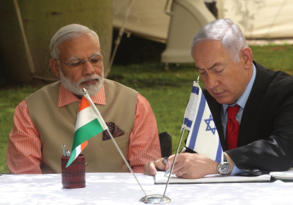 PRIME MINISTER of India Narendra Modi looks on during his 2017 visit to Israel as Prime Minister Benjamin Netanyahu signs a document of cooperation. (photo credit: MARC ISRAEL SELLEM/THE JERUSALEM POST)