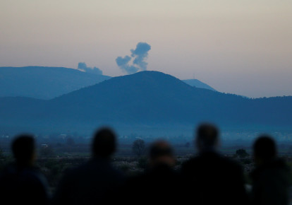Smoke rises from a target hit by Turkish forces in Afrin, Syria, January 20, 2018 (photo credit: OSMAN ORSAL/REUTERS)
