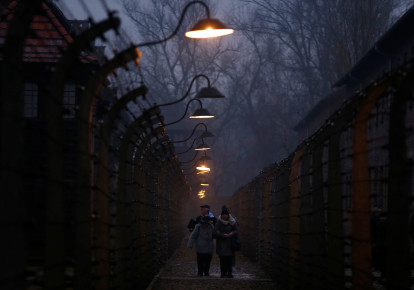 Survivors and guests walk inside the barbed wire fences at Auschwitz, during ceremonies marking the 73rd anniversary of the liberation of the camp, in Oswiecim, Poland, January 27, 2018. (photo credit: REUTERS/KACPER PEMPEL)