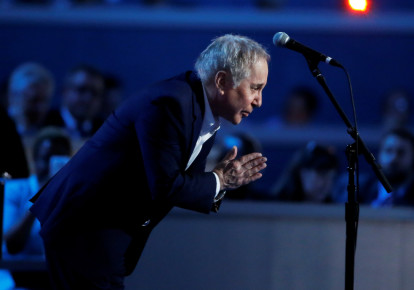 "Singer Paul Simon bows after performing ""Bridge Over Troubled Water"" during the Democratic National Convention in Philadelphia, Pennsylvania (photo credit: REUTERS/LUCY NICHOLSON)"