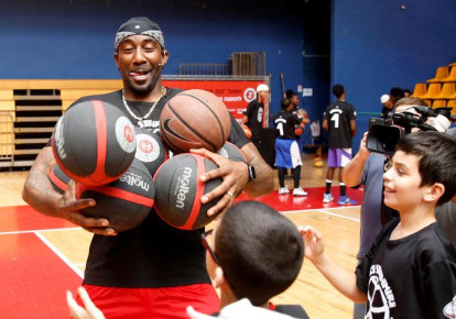 "Former NBA player Amar'e Stoudemire smiles during a basketball workshop for youth entitled ""Amar'e Stoudemire 2016 Basketball Peace Camp"", August 8, 2016.  (photo credit: RONEN ZVULUN/REUTERS)"