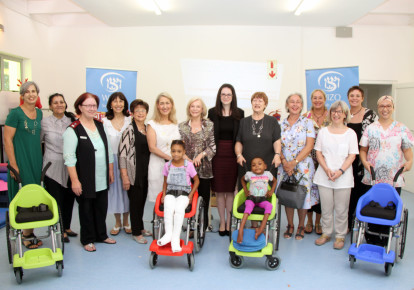 Members of WIZO South Africa, Israeli NGO Wheelchairs of Hope and the Israeli Embassy pose with nurses and disabled children at Maitland Cottage Children's Orthopaedic Hospital in Cape Town (photo credit: COURTESY WIZO)