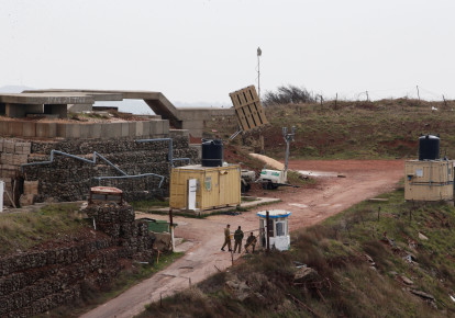 Israeli soldiers walk next to an anti-missile battery at a military post near the Druze village of Majdal Shams in the Golan Heights, Israel February, 2018  (photo credit: AMMAR AWAD / REUTERS)