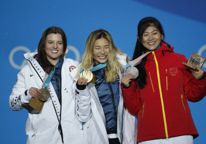 Medals Ceremony - Snowboarding - Pyeongchang 2018 Winter Olympics - Women's Halfpipe - Medals Plaza - Pyeongchang, South Korea - February 13, 2018 - Gold medalist Chloe Kim of the U.S., silver medalist Liu Jiayu of China and bronze medalist Arielle Gold of the U.S. on the podium.  (photo credit: KIM HONG-JI/ REUTERS)
