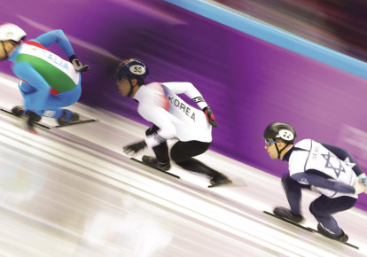 Israeli speedskater Vladislav Bynakov (right) competes in the men's 1,000 meters at the 2018 Pyeongchang Olympics (photo credit: REUTERS)