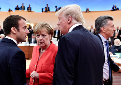 US President Donald Trump, German Chancellor Angela Merkel and French President Emmanuel Macron at the G-20 Summit in Hamburg, Germany, 2017 (photo credit: POOL)