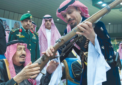 SAUDI ARABIA'S King Salman bin Abdulaziz Al Saud (left) attends a ceremony of the traditional Ardha sword dance as part of the activities of Janadriyah Culture festival, in Riyadh, last month (photo credit: REUTERS)