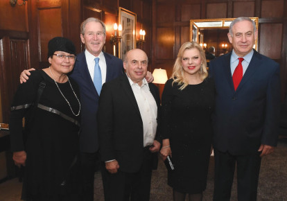 AVITAL SHARANSKY, former US president George W. Bush, Jewish Agency chairman Natan Sharansky, and Prime Minister Benjamin Netanyahu and his wife, Sara, pose together at a gala dinner in New York honoring the outgoing Jewish Agency chairman (photo credit: HAIM ZACH/GPO)