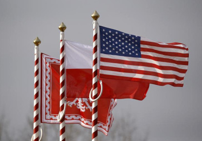 U.S. (R to L), Poland's flags and jack of the President of Poland are seen during the inauguration ceremony of bilateral military training between U.S. and Polish troops in Zagan, Poland, January 30, 2017. (photo credit: KACPER PEMPEL/REUTERS)
