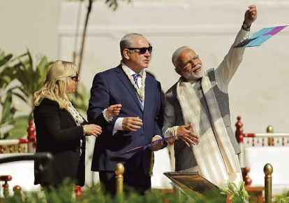 Prime Minister Benjamin Netanyahu and his wife, Sara, watch as Indian Prime Minister Narendra Modi flies a kite in Ahmedabad in January (photo credit: REUTERS/AMIT DAVE)