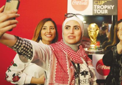 Soccer fans take selfies during the FIFA World Cup Trophy Tour last month in Amman, Jordan (photo credit: MUHAMMAD HAMED/REUTERS)