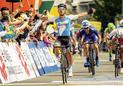 Israel Cycling Academy's Colombian sprinter Edwin Avila raises his hands in triumph after winning Stage 3 of the Tour de Taiwan yesterday, the team's first win of the 2018 season. Another part of the team's squad completed its participation yesterday in the snowy Tirreno Adriatico (inset), an elite  (photo credit: NOA ARNON)