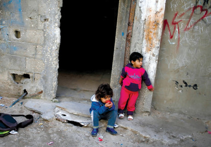 IMPOVERISHED CHILDREN in Gaza City's Shati refugee camp. (photo credit: MOHAMMED SALEM/REUTERS)