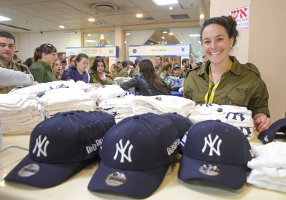 dce96b9fe NY Yankees president and wife donate hats to IDF lone soldiers ...