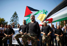 Palestinians parade during celebrations after Hamas said it reached a deal with Palestinian rival Fa