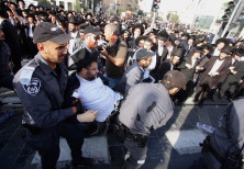 Police arrest a haredi man protesting against the drafting of ultra-Orthodox into the IDF, October 2