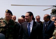 Lebanese Prime Minister Saad al-Hariri arrives with Army Commander General Joseph Aoun (L) at the Un