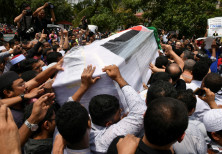 People carry the coffin with the body of Palestinian man Fadi al-Batsh, who was shot to death