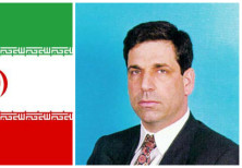 Gonen Segev (R) and the Iranian flag