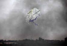 A kite flies over the border in an area where kites and balloons have caused blazes, between Israel