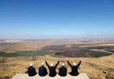 Israeli Druze watch the Syrian side of the Israel- Syria border on the Golan Heights on July 7, 2018