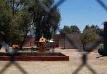 A playground for detained children is seen through chain link fencing as U.S. first lady Melania Tru