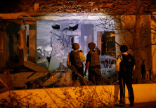 Security personnel check a damaged house in the Israeli city of Ashkelon, following a rocket attack