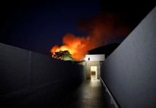 Flames rise after a rocket attack in Sderot, near the Israeli side of the Israel-Gaza border, Novemb