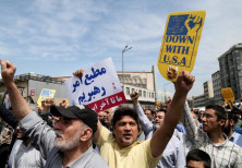 Iranians shout slogans during a protest in Tehran, Iran, against President Donald Trump