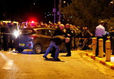 Israeli security forces and emergency personnel work at the scene of what an initial report from the