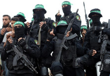 Palestinian Hamas militants attend the funeral of their comrades who were killed in an explosion, in