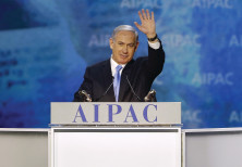PRIME MINISTER Benjamin Netanyahu waves at the crowd at the AIPAC Policy Conference in 2015.