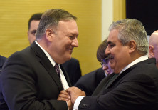 US Secretary of State Mike Pompeo (L) greets Bahrain Foreign Minister Khalid bin Ahmed al-Khalifah