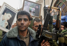 Zakariya Zubeidi, then-leader of Al Aqsa martyrs brigades looks on during a demonstration