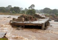 A man looks at a washed away bridge along Umvumvu river following Cyclone Ida