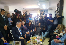 Prime Minister Benjamin Netanyhu (L) visits the shiva house of Rabbi Ahiad Ettinger