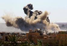 Smoke rises from the last besieged neighborhood in the village of Baghouz, Deir Al Zor province