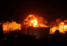 Flame and smoke are seen during an Israeli air strike in Gaza City March 25, 2019