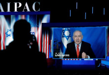 Speaking via satellite feed from Israel, Israeli Prime Minister Benjamin Netanyahu addresses AIPAC i