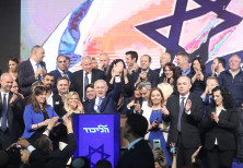 Likud Knesset members celebrate with Prime Minister Netanyahu and his wife after the elections.